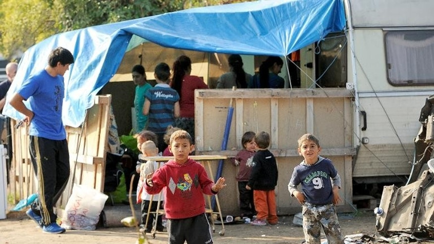 Roma children stand in their camp in Roubaix, northern France, on October 1, 2013