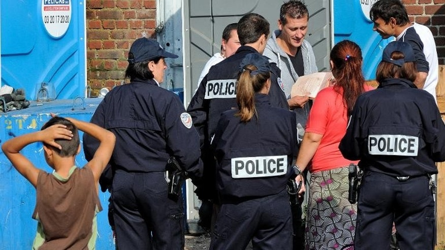 French police as carry out identity checks at a Roma camp in Roubaix, northern France, on October 1, 2013