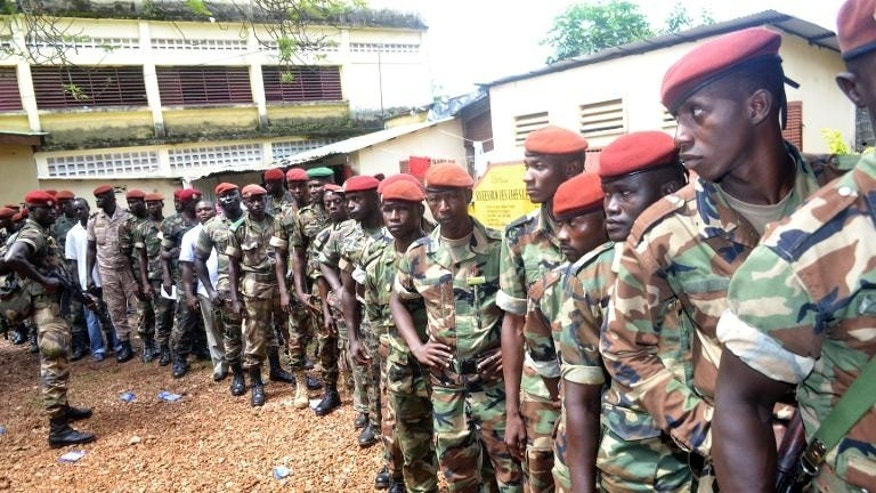 Guinean soldiers queue to vote at a polling station in the capital Conakry on September 28, 2013
