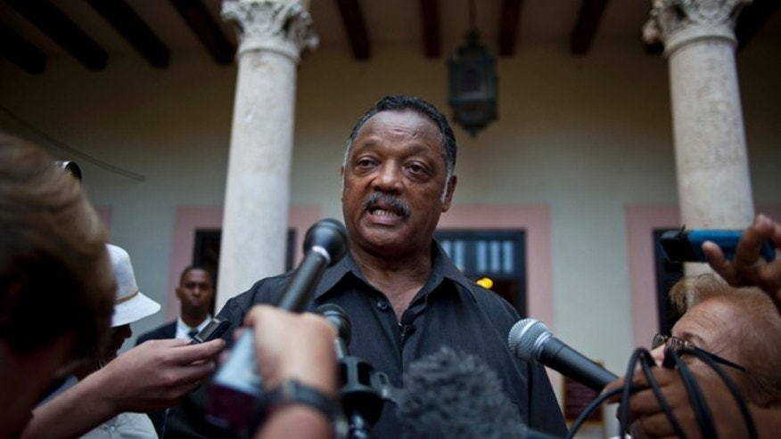 Rev. Jesse Jackson talks with journalists after a meeting with members of FARC in Havana, Cuba, Sunday, Sept. 29, 2013.