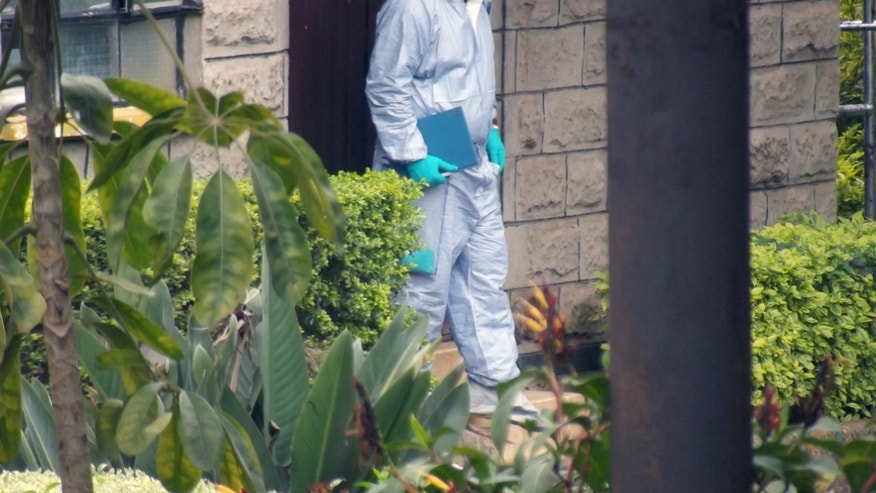 A foreign forensic examiner at the Nairobi City Mortuary where a group have arrived to take DNA tests, Wednesday, Oct.2, 2013 following the attack on a shopping mall in the city that left at least 67 dead including 18 foreigners. (AP Photo/Sayyid Azim)