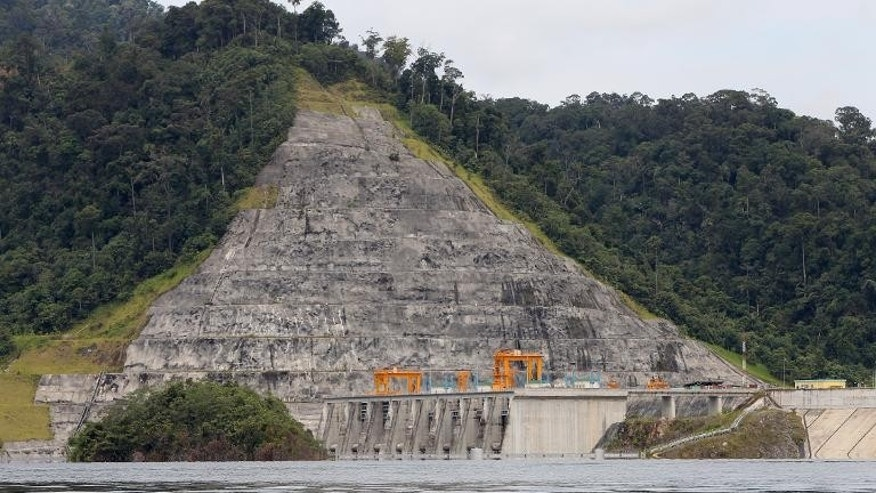 Malaysia's government agreed to pay $133 million in compensation to two foreign contractors for losses incurred in the problem-plagued Bakun Dam, shown here in 2011, an audit has revealed