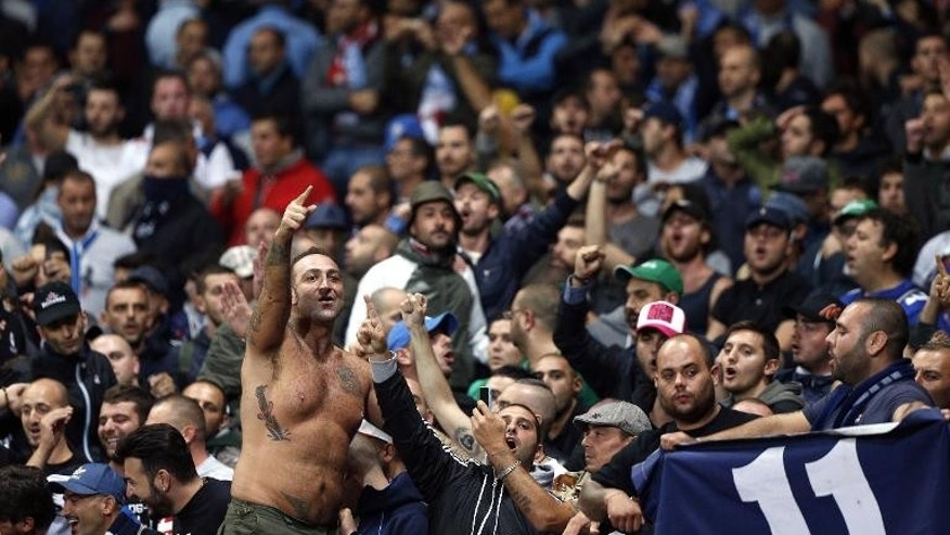 SSC Napoli fans enjoy the atmosphere before the start of the Champions League Group F match against Arsenal at the Emirates Stadium in north London, on October 1, 2013