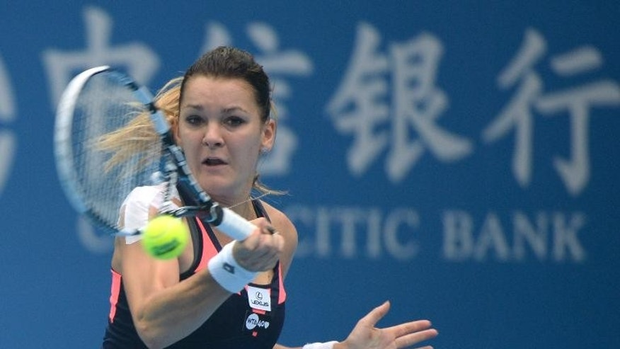 Agnieszka Radwanska of Poland returns to Stefanie Voegele of Switzerland during their women's single match at the China Open tennis tournament in Beijing on September 29, 2013