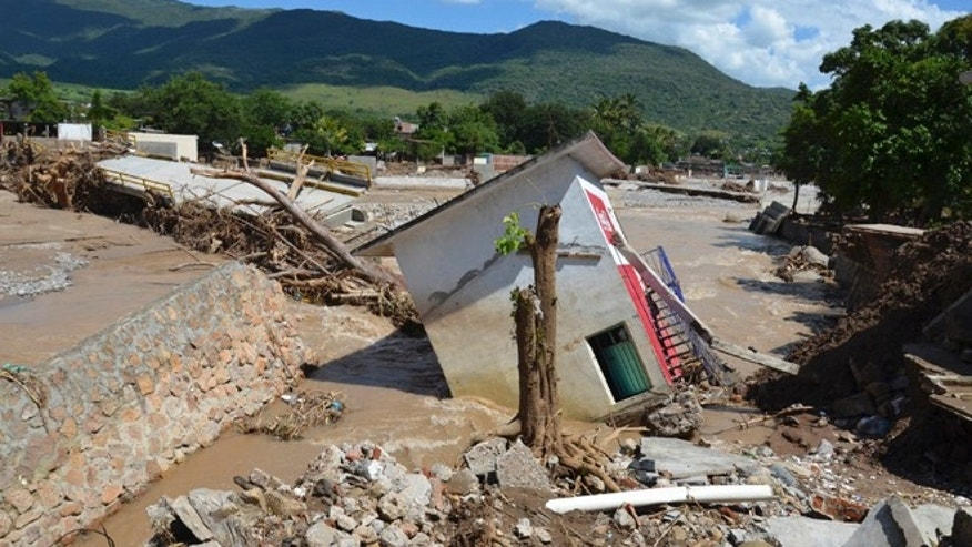 Sept. 29, 2013: Building and bridges lie in rubble after the passing of Tropical Storm Manuel in the town of Quechultenango, Mexico.