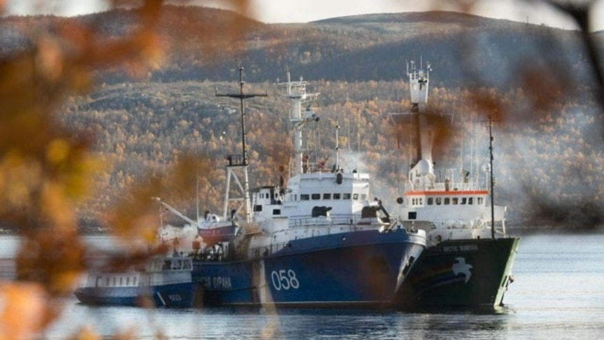 October 1, 2013: In this image made available by Greenpeace, the Greenpeace ship, the Arctic Sunrise, right, is anchored side by side with the Russian Coast Guard Ship in the Kolskii gulf, near Murmansk, Russia on Monday, Sept. 30, 2013. (AP Photo)