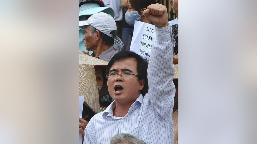 Vietnamese lawyer Le Quoc Quan chants slogans during an anti-China rally in Hanoi, on July 8, 2012