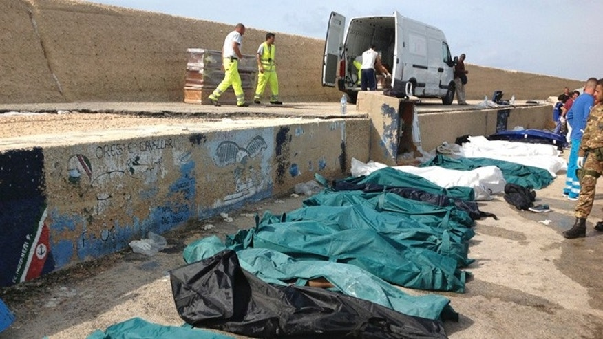 Oct. 3, 2013: Bodies of drowned migrants are lined up in the port of Lampedusa.