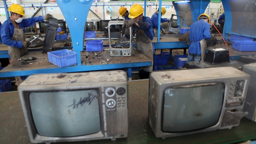 In this photo taken on Aug 28, 2013, workers dismantle television sets for recycling at a workshop in an environmental technology company in Zhuzhou in southern China's Hunan province. China's recycling industry has boomed over the past 20 years. Its manufacturers needed the metal, paper and plastic and Beijing was willing to tolerate the environmental cost. But environmentalists have long complained the industry is poisoning China's air, water and soil. (AP Photo) CHINA OUT