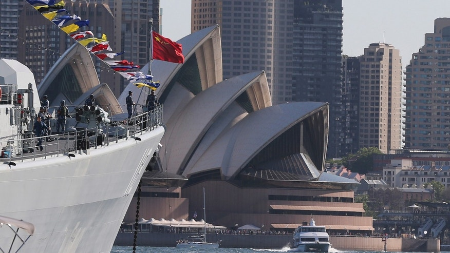 Chinese warships Plan Qingdao anchors in Sydney Harbor with the Opera House in the background during the International Fleet review in Sydney, Australia, Friday, Oct. 4, 2013. The warship will join about 40 others in the Fleet Review to commemorate the centenary of the first entry of the Royal Australian Navy fleet into Sydney Harbor on October 4, 1913.(AP Photo/Rob Griffith)