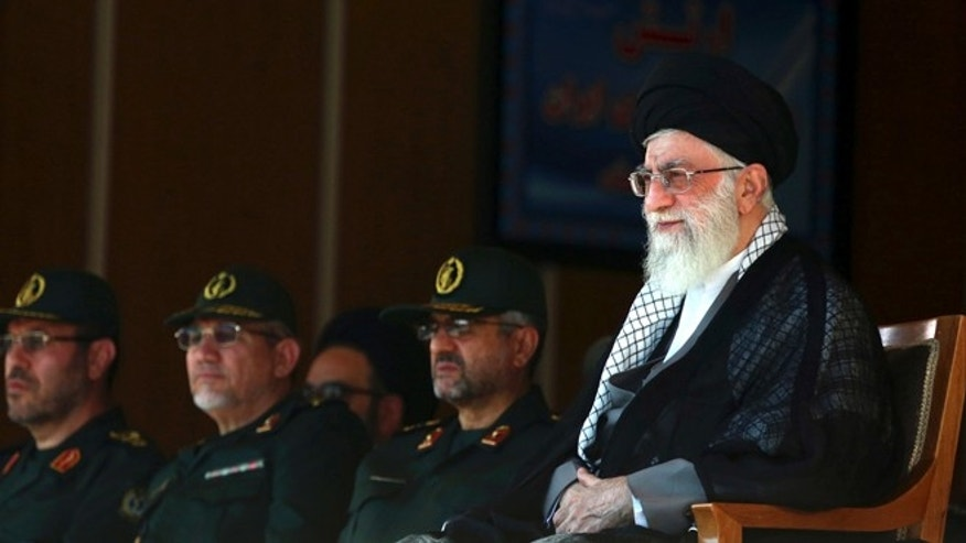 In this picture released by an official website of the office of the Iranian supreme leader, Supreme Leader Ayatollah Ali Khamenei, right, attends a graduation ceremony of army cadets.