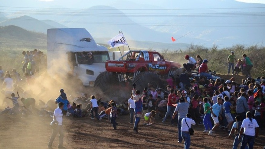 Oct. 5, 2013: People run as an out of control monster truck plows through a crowd of spectators at a Mexican air show in the city of Chihuahua, Mexico. According to authorities, at least 8 people were killed and 80 were injured.