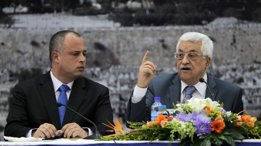 Israeli MP Labour Party member Hilik Bar, left, listens Palestinian President Mahmoud Abbas at a meeting with Knesset members in the West Bank city of Ramallah on Monday, Oct. 7, 2013. (AP Photo/Abbas Momani, Pool)