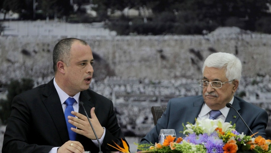 Israeli MP Labor Party member Hilik Bar, left, and Palestinian President Mahmoud Abbas attend a meeting with Knesset members in the West Bank city of Ramallah on Monday, Oct. 7, 2013. (AP Photo Abbas Momani, Pool)