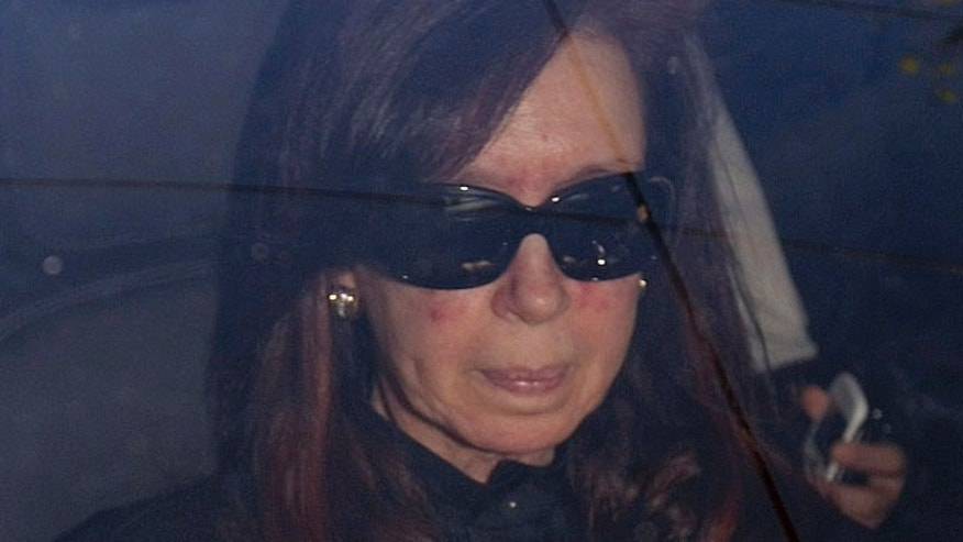 Oct. 7: President Cristina Fernandez arrives to a local hospital in Buenos Aires.