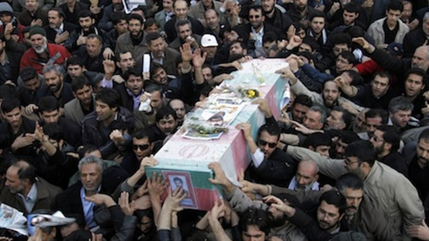Iranians mourn nuclear scientists killed last year in an apparent assassination. But Tehran is not saying the latest death of a top scientist was the work of Israel. (AP)