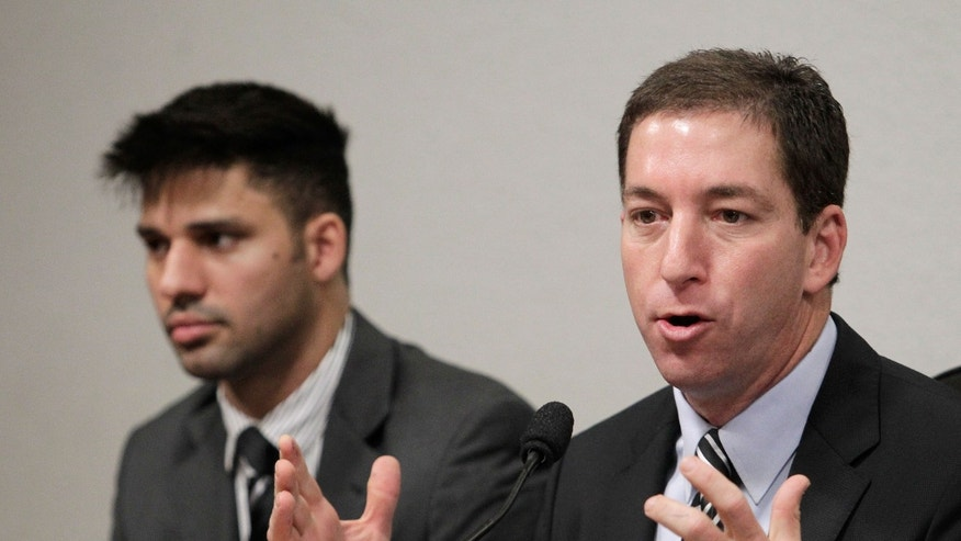 "American journalist Glenn Greenwald, right, speaks to a congressional committee investigating reports based on documents, leaked by former National Security Agency contractor Edward Snowden, showing that Brazil was targeted by spy agencies from the U.S., Britain and Canada, at Congress in Brasilia, Brazil, Wednesday, Oct. 9, 2013. At left his Greenwald's partner David Miranda. Greenwald, the who broke the first stories about the NSA's global spy program, told the committee that the U.S. government ""lies"" when it says that the aim of the NSA spy program is to combat terrorism.  (AP Photo/Eraldo Peres)"