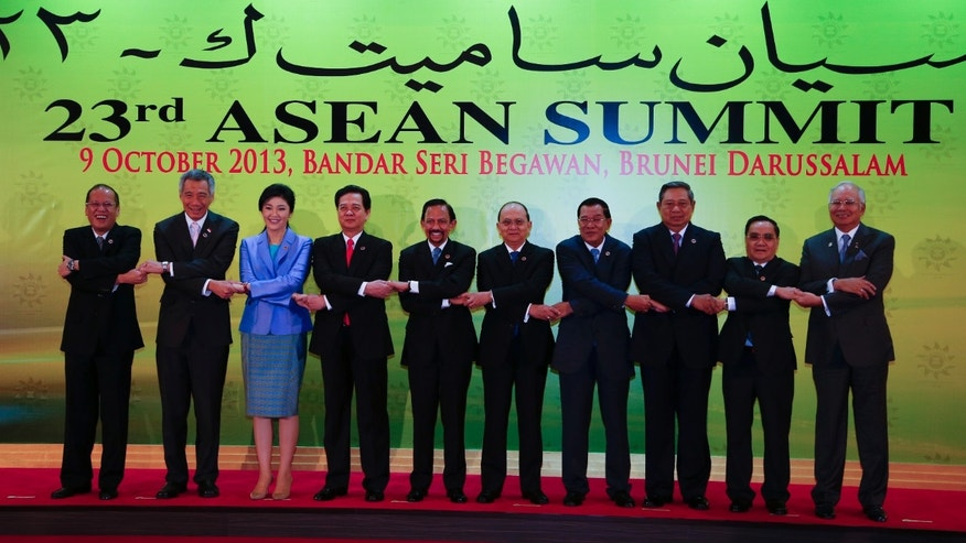 Leaders of the Association of Southeast Asian Nations (ASEAN) pose for a group photo session during ASEAN summit in Bandar Seri Begawan, Brunei, Wednesday, Oct. 9, 2013.  From left, Philippines President Benigno Aquino III, Singapore's Prime Minister Lee Hsien Loong, Thai Prime Minister Yingluck Shinawatra,Vietnamese Prime Minister Nguyen Tan Dung, Brunei Sultan Hassanal Bolkiah, Myanmar President Thein Sein, Cambodian Prime Minister Hun Sen, Indonesian President Susilo Bambang Yudhoyono, Laotian Prime Minister Thongsing Thammavong and Malaysia's Prime Minister Najib Razak. (AP Photo/Vincent Thian)