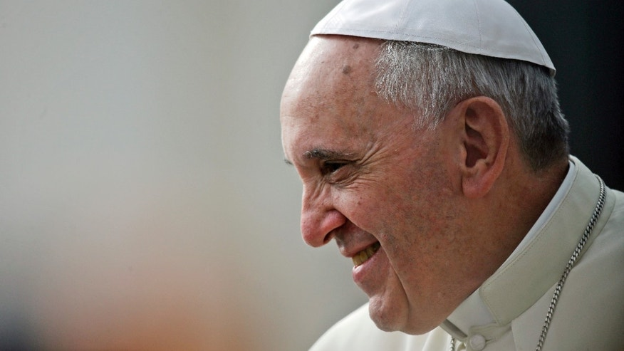 Pope Francis smiles during the weekly general audience in St. Peter's Square, at the Vatican, Wednesday, Oct. 9, 2013. (AP Photo/Gregorio Borgia)