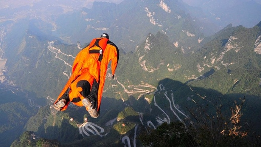 Oct. 8, 2013: In this photo, Hungarian wingsuit flier Viktor Kovats jumps off a mountain at Tianmen Mountain National Forest Park in Zhangjiajie in south China's Hunan province. Kovats died during this fatal jump into a gorge. His body was recovered Wednesday from the steep, forested valley floor at the park, state broadcaster CCTV said. The reports said the highly experienced Kovats apparently died from a head injury after crashing into a cliff-side. His 2,290-foot jump Tuesday afternoon was part of preparations for the Second World Wingsuit Championship being held in the park from Oct. 11 to 13.