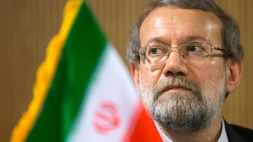 Oct. 9, 2013: Iran's Parliament speaker Ali Larijani listens to a question during a press conference on the sidelines of the 129th Assembly of the Inter-Parliamentary Union (IPU), in Geneva, Switzerland.