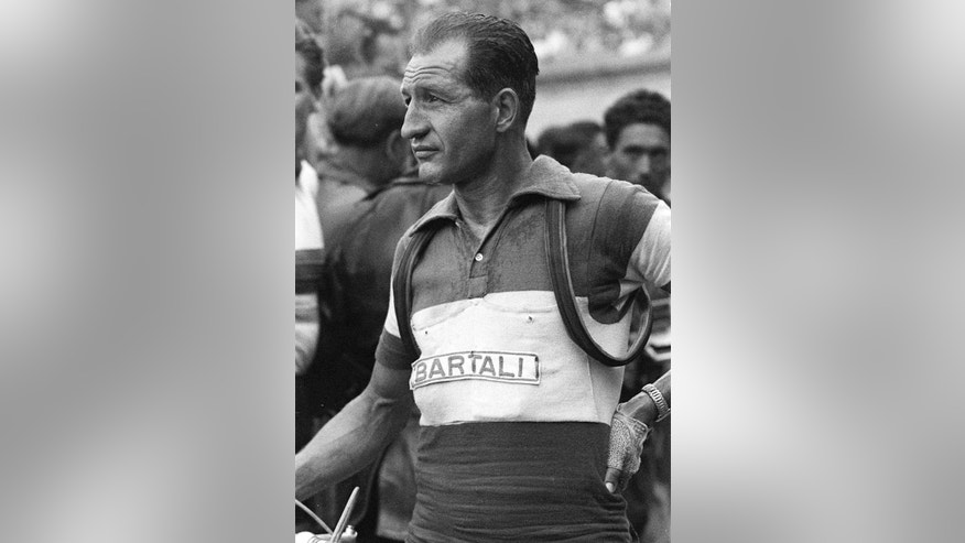 FILE -- Italian cycling great Gino Bartali is seen in this 1953 file picture. On Thursday, Oct. 10, 2013, a ceremony was held at the Jerusalem Holocaust memorial Yad Vashem to induct Bartali into the prestigious Garden of the Righteous Among the Nations for his help rescuing Jews during World War II. During the German occupation of Italy, the champion cyclist aided the Jewish-Christian rescue network in his hometown of Florence and the surrounding area by shuffling forged documents and papers hidden in the tubes and seat of his bike. Bartali, who died in 2000, rarely spoke about it for the rest of his life but his son Andrea Bartali led an effort to gain recognition for what his father did. (AP Photo)
