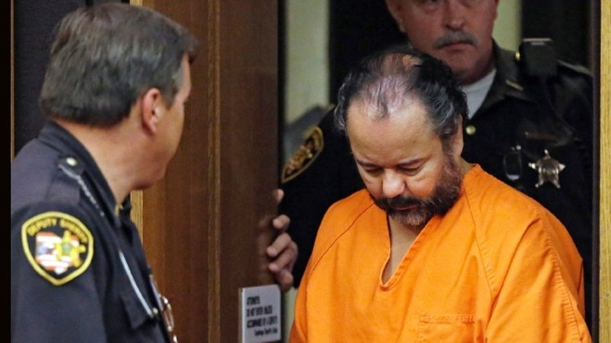 Ariel Castro is led into Cuyahoga County Common Pleas Court in Cleveland for a pretrial hearing on July 3, 2013.