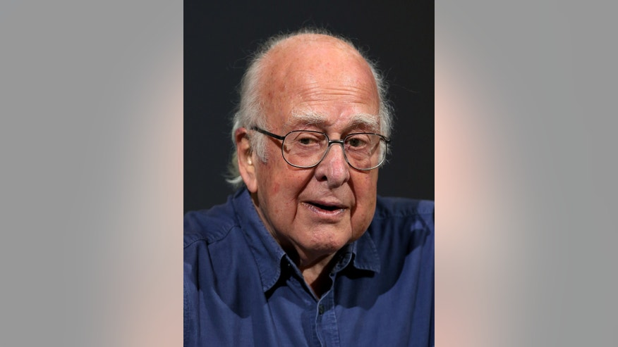 Britain's Professor Peter Higgs pauses,  during a press conference,  in Edinburgh, Scotland Friday, Oct. 11, 2013. Nearly 50 years after they came up with the theory, but little more than a year since the world's biggest atom smasher delivered the proof, Professor Higgs and Belgian colleague Francois Englert won the Nobel Prize in physics Tuesday for helping to explain how matter formed after the Big Bang.  (AP Photo/Scott Heppell)