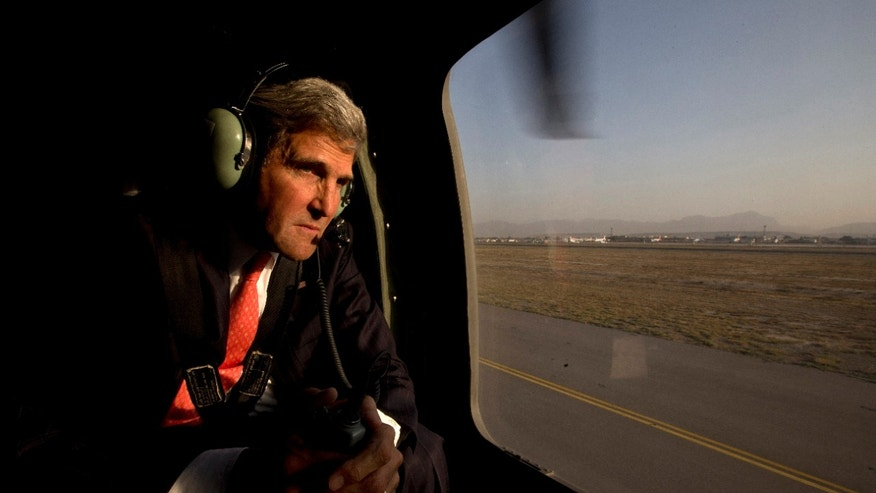 U.S. Secretary of State John Kerry takes off in a black hawk helicopter in Kabul, Afghanistan, after arriving on an unannounced visit to meet with Afghan President Hamid Karzai Friday, Oct. 11, 2013. (AP Photo/Jacquelyn Martin, Pool)