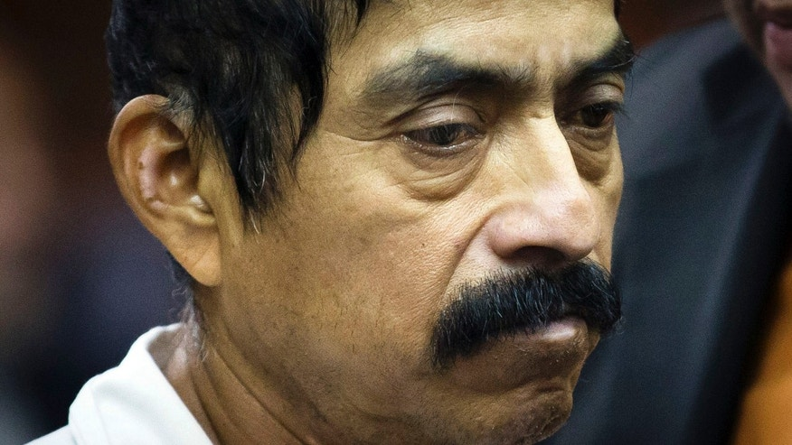 "Conrado Juarez, 52, is arraigned at Manhattan Criminal Court for the alleged murder of 4-year-old Anjelica Castillo, nicknamed ""Baby Hope"", Saturday, Oct. 12, 2013, in New York. Castillo's body was discovered inside a picnic cooler beside a Manhattan highway in 1991, resulting in a decades old investigation that led to Juarez's arrest and admission that he sexually assaulted and smothered her. (AP Photo/John Minchillo, Pool)"