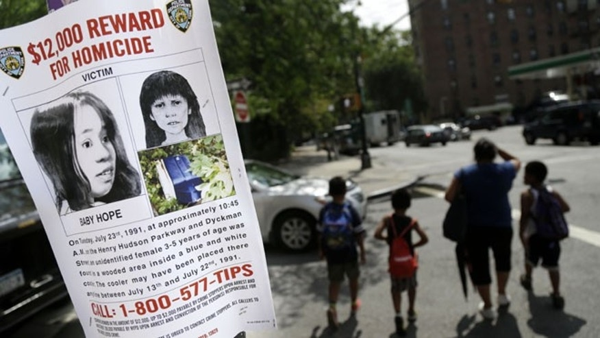 July 23, 2013: This photo shows a poster soliciting information regarding an unidentified body near the site where the body was found in New York.