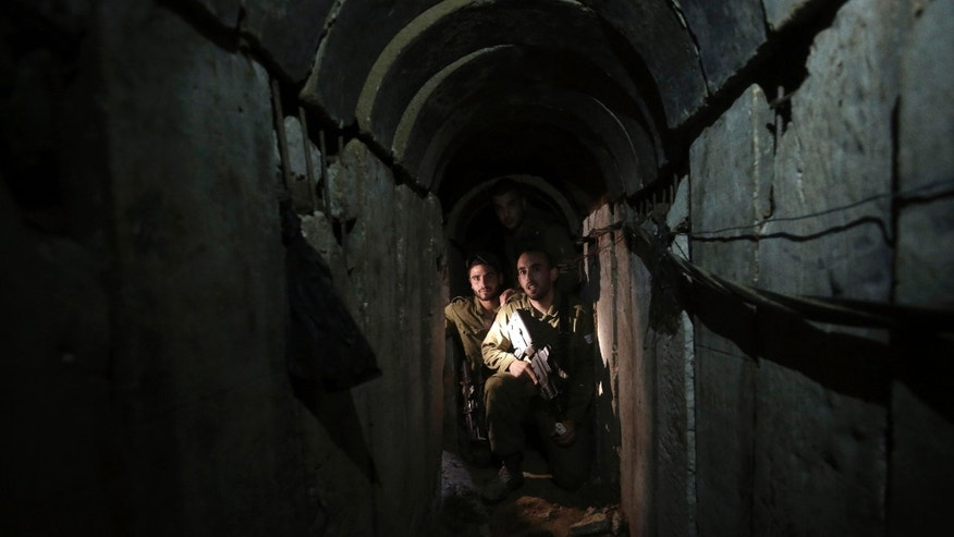 Oct. 13, 2013 - Israeli soldiers walk through a tunnel discovered near the Israel Gaza border.