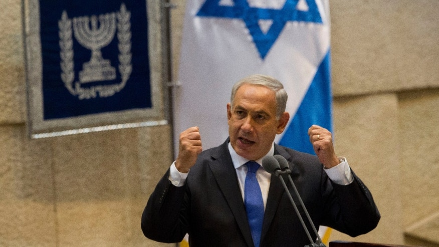 """Israel's Prime Minister Benjamin Netanyahu speaks during the opening session of the Knesset, Israel's parliament, in Jerusalem, Monday, Oct. 14, 2013. Israel's prime minister says he is making a """"real effort"""" to reach peace with the Palestinians, but is giving no signs of progress in recently relaunched negotiations. In a speech to parliament on Monday, Netanyahu vowed to maintain a hard line in the negotiations. (AP Photo/Ariel Schalit)"""