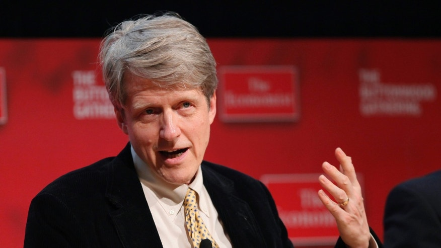 FILE - In the Tuesday, Oct. 26, 2010, file photo, Robert Shiller, professor of economics at Yale, speaks at the Buttonwood Gathering, in New York. Americans Shiller, Eugene Fama and Lars Peter Hansen have won the Nobel Memorial Prize in Economic Sciences, Monday, Oct. 14, 2013. (AP Photo/Mark Lennihan, File)
