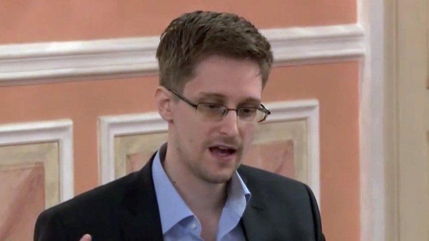 In this image made from video released by WikiLeaks on Friday, Oct. 11, 2013, former National Security Agency systems analyst Edward Snowden speaks during a presentation ceremony for the Sam Adams Award in Moscow, Russia. Snowden was awarded the Sam Adams Award, according to videos released by the organization WikiLeaks. The award ceremony was attended by three previous recipients. (AP Photo)