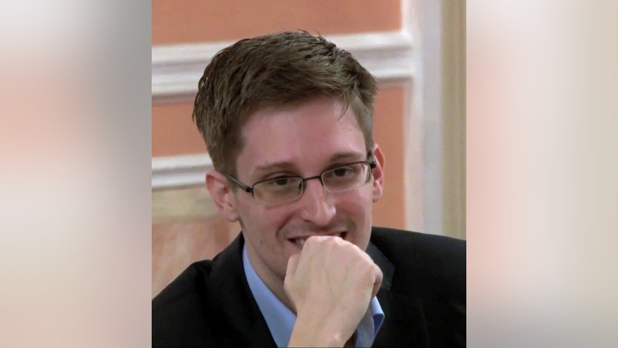In this image made from video released by WikiLeaks on Friday, Oct. 11, 2013, former National Security Agency systems analyst Edward Snowden smiles during a presentation ceremony for the Sam Adams Award in Moscow, Russia. Snowden was awarded the Sam Adams Award, according to videos released by the organization WikiLeaks. The award ceremony was attended by three previous recipients. Snowden, who is charged by a U.S. court with violating the Espionage Act for disclosing the classified NSA programs, has been granted asylum in Russia. (AP Photo)