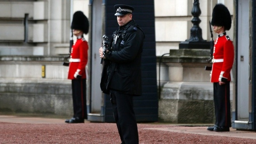 Oct. 14, 2013: A British police officer guards the grounds of Buckingham Palace in central London.