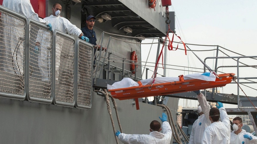 Oct. 12, 2013: In this file photo, a body is lowered down from a Maltese Navy ship at the Valletta harbor, Malta after a Maltese ship brought 143 survivors from a capsized smugglers' boat after 34 people drowned when the boat capsized. Most of the migrants in the latest tragedy were fleeing civil war in Syria. A sharp rise in the number of Syrians attempting the perilous sea voyage over the past three months highlights the crushing life-and-death decisions facing many who fled to Egypt to escape Syria's armed conflict, according to rights group Amnesty International.