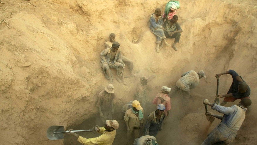 FILE - in this file photo taken Wednesday, Nov. 1, 2006, illegal miners dig for diamonds in Marange, Zimbabwe. The wealth enjoyed by just a few comes, at least in part, from the vast Marange diamond field that was exposed by an earth tremor in 2006. The Marange deposit is the biggest diamond field found in Africa for a century, estimated to be worth some billions of dollars, but as most Zimbabweans remain mired in poverty, questions are being asked about where all the money went and who benefited. (AP Photo/Tsvangirayi Mukwazhi, FILE)