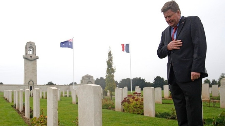 Oct 16, 2013: Australian Minister for Veterans Affairs, Michael Ronaldson looks at a tombstone of Australian soldiers in the Australian National Memorial of Villers-Bretonneux, northern France, where hundreds of Australian soldiers and other allied troops died to help save the French village in World War I.