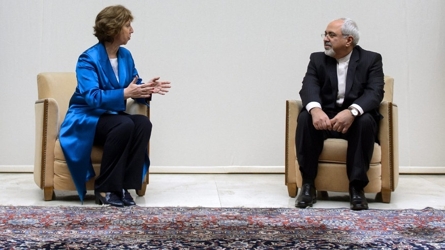 EU High Representative for Foreign Affairs Catherine Ashton, left, talks to Iranian Foreign Minister Mohammad Javad Zarif, right, during a photo opportunity prior to the start of two days of closed-door nuclear talks Tuesday, October 15, 2013, at the United Nations offices in Geneva, Switzerland. Iran's overtures to the West are being tested as the U.S. and its partners sit down for the first talks on Tehran's nuclear program since the election of a reformist Iranian president. Negotiations between Iran and the U.S., Russia, China, Britain, France and Germany began Tuesday morning at the main United Nations building in Geneva. (AP Photo/Fabrice Coffrini, pool)