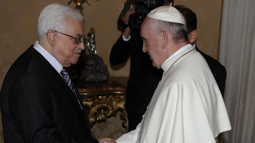 Oct. 17, 2013 - Pope Francis shakes hands with  Mahmoud Abbas, President of the Palestinian Authority, during their private audience  at the Vatican.