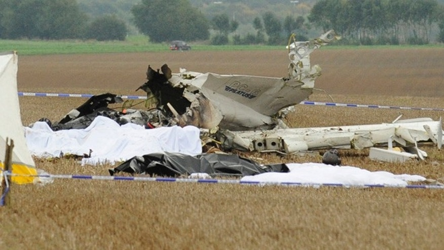 Oct. 19, 2013: Bodies are covered near the debris of a small plane which crashed in a field in Marchovelette, Belgium. The plane, carrying parachutists for a skydiving trip, crashed killing all 11 people aboard, officials said.