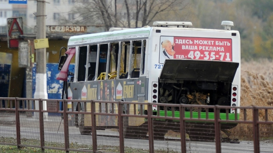 Oct. 21, 2013 - A damaged bus is examined by experts in Volgograd. The blast was caused by an unspecified explosive device, the National Anti-Terrorism Committee said in a statement. At least five died and 32 were injured.