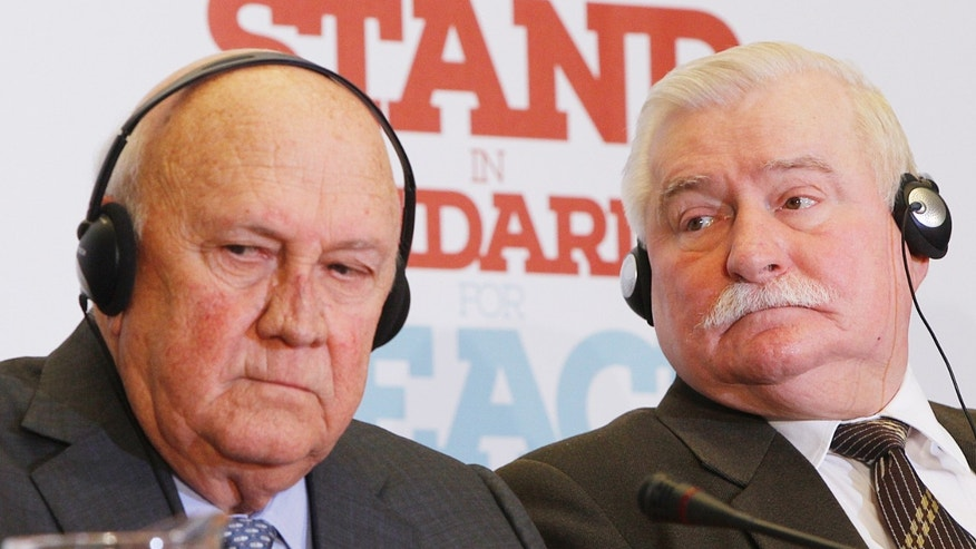 Former Polish President Lech Walesa,right, and former President of the Republic of South Africa, Frederik de Klerk,left, attend a news conference in Warsaw, Poland, on Sunday, Oct. 20, 2013, on the eve of a three-day meeting of Nobel Peace Prize laureates here. De Klerk said Africa should be given due place on the international arena. (AP Photo/Czarek Sokolowski)