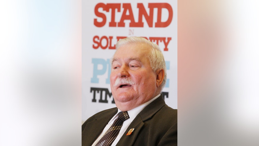 Former Polish President Lech Walesa speaks during a news conference in Warsaw, Poland, Sunday, Oct. 20, 2013, on the eve of a three-day meeting of Nobel Peace Prize laureates.(AP Photo/Czarek Sokolowski)