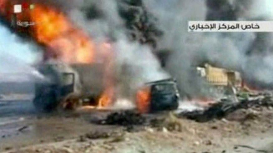Oct. 20, 2013: This image made from video made from Syrian state television shows the aftermath of a truck bomb attack in Hama, Syria.