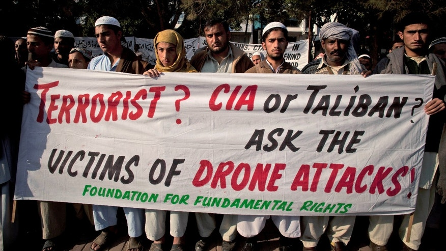 In this Friday, Dec. 10, 2010 file photo, Pakistani tribal villagers hold a rally to condemn the U.S. drone attacks on their villages in border areas along the Afghanistan border, in Islamabad, Pakistan. Amnesty International calls on the U.S. to investigate reported civilian casualties from CIA drone strikes in Pakistan and compensate victims in a report providing new details about innocent citizens allegedly killed in the attacks.