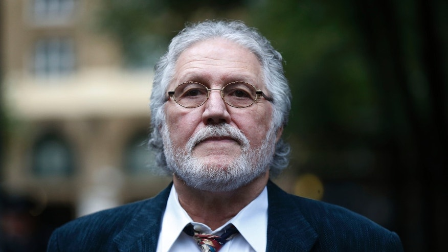 British disc jockey Dave Lee Travis arrives for his hearing at Southwark Crown Court in London, Tuesday, Oct. 22, 2013.  Travis, 68, whose real name is David Patrick Griffin, has been charged with 14 counts of indecent assault and one count of sexual assault against alleged victims aged between 15 and 29 between 1977 and 2007. He denies all charges.  (AP Photo/Sang Tan)