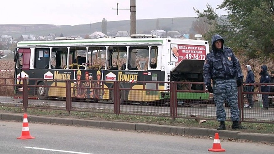 Oct. 22, 2013: In this image made from video, experts and officials examine a wreckage of a bus in Volgograd, Russia. A female suicide bomber blew herself up on the city bus in southern Russia on Monday, killing six people and injuring about 30, officials said. The attack in Volgograd added to security fears ahead of the Winter Olympics in Sochi.